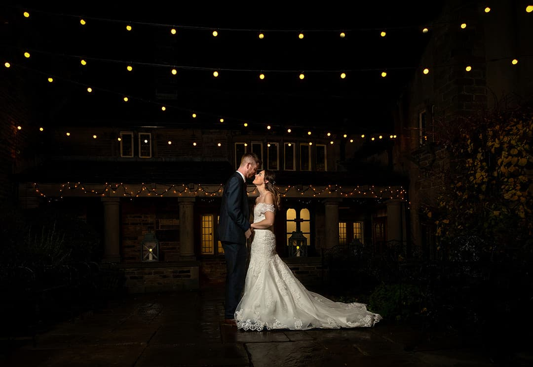 Halifax_wedding_photographer | bride_and_groom_with_twinkly_lights_in_courtyard